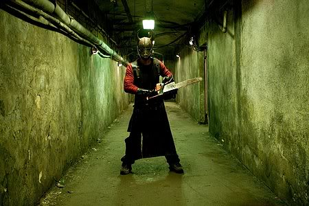 hostel-man-with-chainsaw